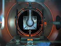DS4G thruster firing during tests in the ESTEC Electric Propulsion facility (CORONA vacuum chamber)