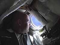 André Kuipers à bord de Soyouz TMA-4, crédits: ESA
