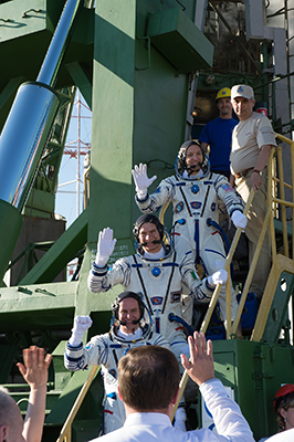 The crew of Expedition 52 wave to well-wishers on the launch pad
