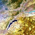 The narrow, man-made Lake Kariba, located along the border of Zambia and Zimbabwe, as seen by Envisat. Lake Kariba was created in the late 1950s by the construction of a largest dam wall across the Zambezi River running through the Kariba Gorge. Today Lake Kariba is one of the largest dams in the world, with a surface area of 5580 square kilometres and an average depth of 29 metres, increasing to a maximum of 97 metres. It is 220 km long and in places up to 40 kilometres wide. The Medium Resolution Imaging Spectrometer (MERIS) acquired this image on 6 June 2005, operating in Full Resolution mode with a spatial resolution of 300 metres. It covers an area of 672 by 672 kilometres.