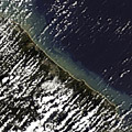 This image acquired on 28 December 2004 by the MERIS (Medium Resolution Imaging Spectrometer) on board ESA's Envisat Earth observation satellite shows the northeast coast of Sri Lanka and the southern coasts of India. Sediment (light brown & green colour) left after the tsunami can be seen along the coast.