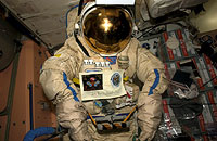 SuitSat in flight configuration. On the top of the helmet is the electronics control panel along with the SuitSat antenna. A new handle has been added around the midsection of the suit to allow the astronaut/cosmonaut to move it safely prior to launch.