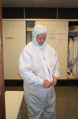 Technician suits up before entering the clean room