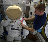 Tim Peake prepares his spacesuit