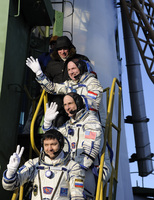 Expeditions 30 and 31 crew members wave goodbye to the crowd
