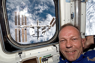 Schlegel in Shuttle aft flight deck after undocking from ISS