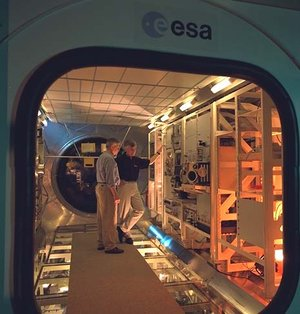 ESA astronaut Ulf Merbold checks out the Biolab glovebox