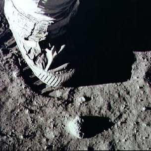 Astronaut's foot and footprint in lunar soil
