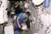 Sergei K. Krikalev and William M.  Shepherd at work in the ISS