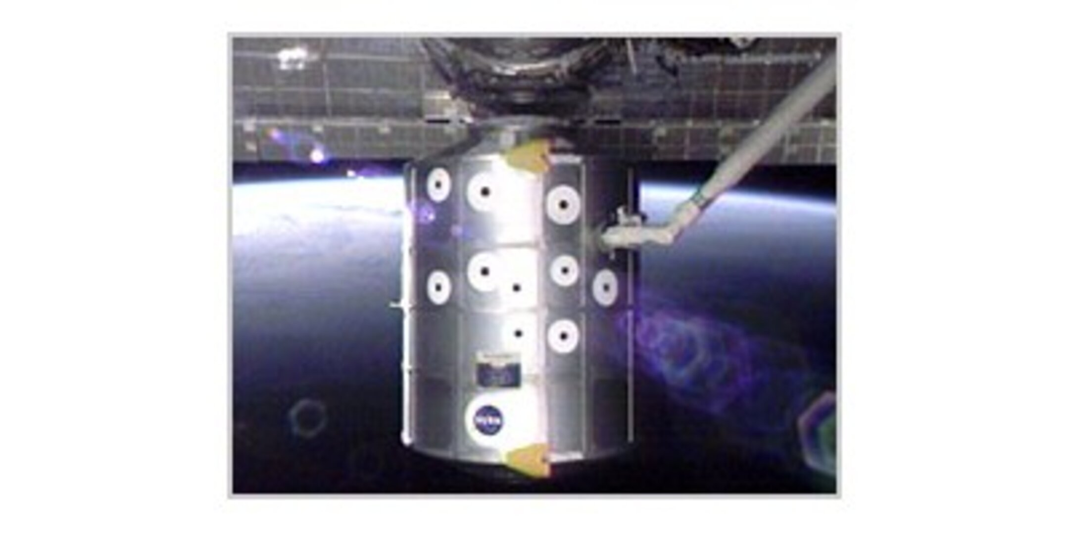 The Raffaello module is moved away from the ISS using Endeavour's robotic arm