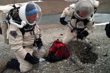 Charles Cockell and Vladimir install dosimeters under gravel rocks