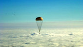 Soyuz descends to Earth on a parachute