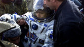 Claudie helped out of the Soyuz