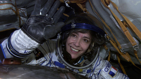 Claudie waves from inside the cramped Soyuz