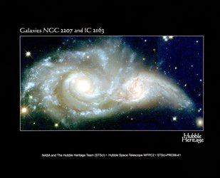 A Grazing Encounter Between Two Spiral Galaxies : Galaxies NGC 2207 and IC 2163