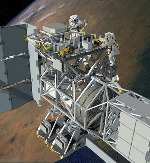 Astronauts working at an external payload site on the ISS Truss Assembly