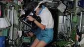 Claudie Haigneré working in the ISS
