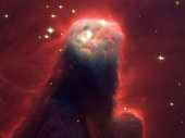 Ghostly star-forming pillar of gas and dust