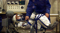 Roberto Vittori dons spacesuit at Baikonour