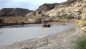 Vladimir Pletser's ATV stuck in the mud in the middle of river