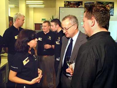 Star Tiger team member speaking with Lord Sainsbury