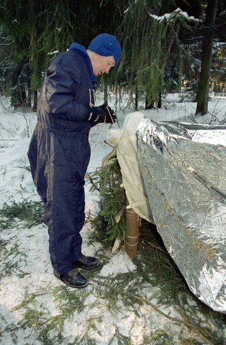 Frank De Winne during his winter survival training in a Russian forest