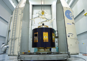 MSG's payload fairing half-shells are moved into position around MSG-1
