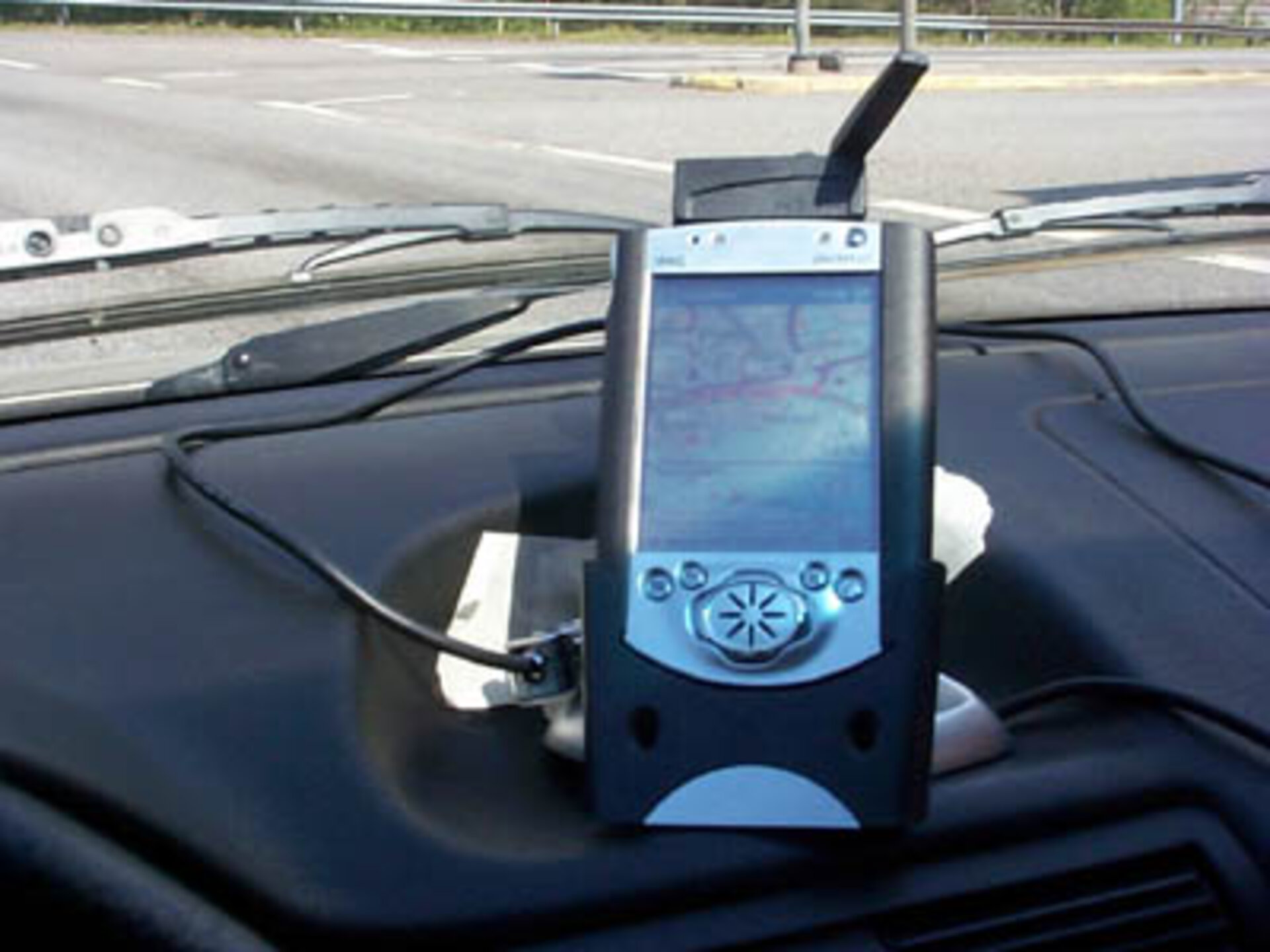 FGI SISNeT hand-held receiver installed in car before testing