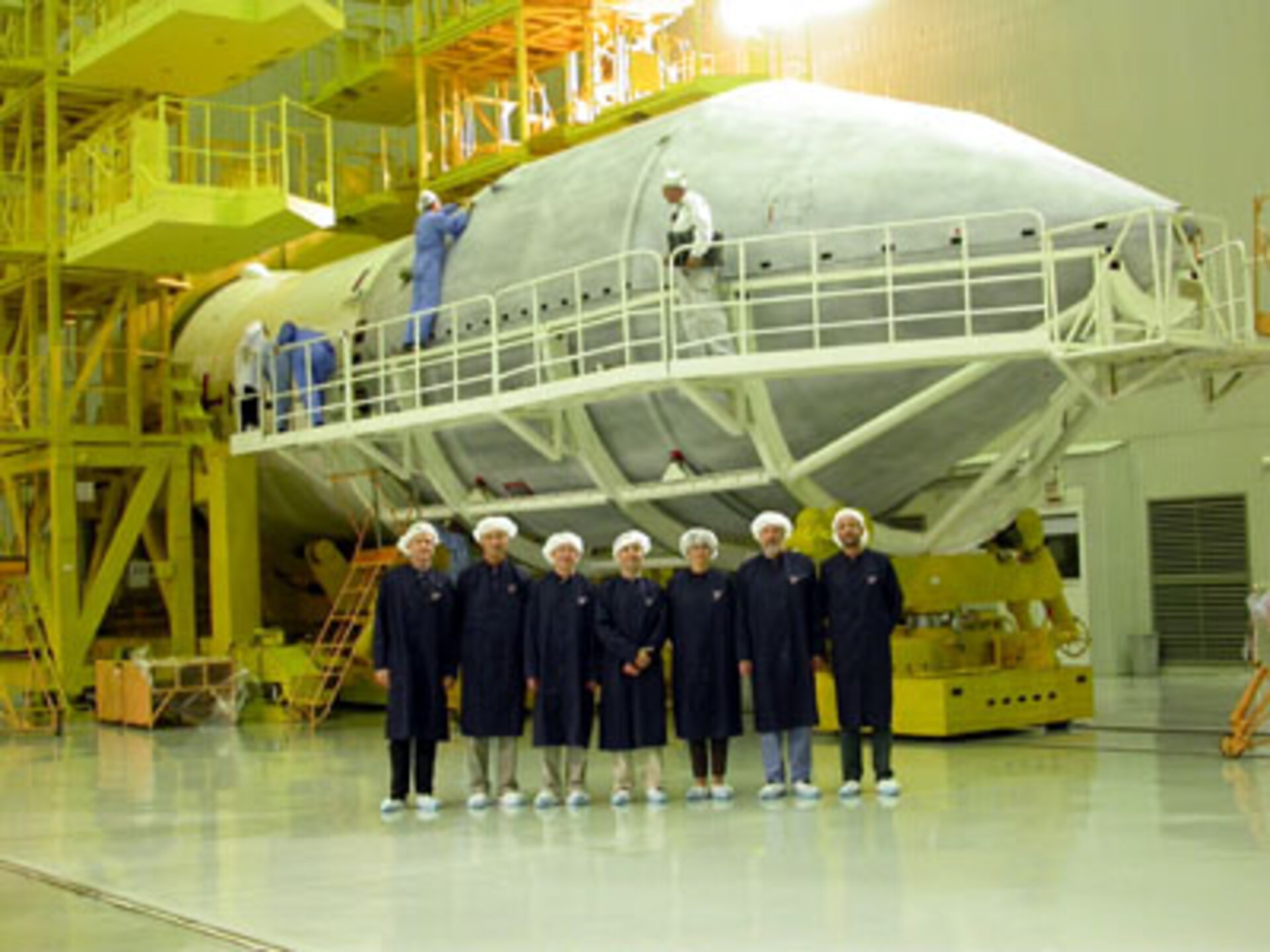 3.10.02.  ESA team members in front of the Proton fairing after  encapsulation