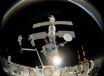 Scene from the IMAX film: ISS reflected in an astronaut's helmet