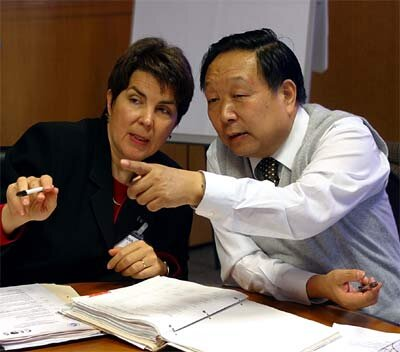 L. Moodie of US NOAA (l) with D. Li of China's Ministry of Science and Technology