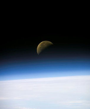 A quarter moon seen from the Space Shuttle Columbia