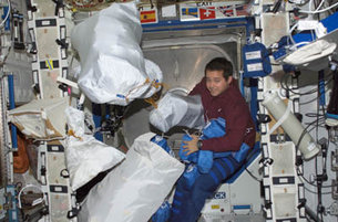 AAstronaut Bursch among 'stowage bags' on ISS