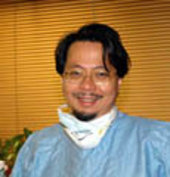 Dr T.C. Ng at work at his dentist's surgery