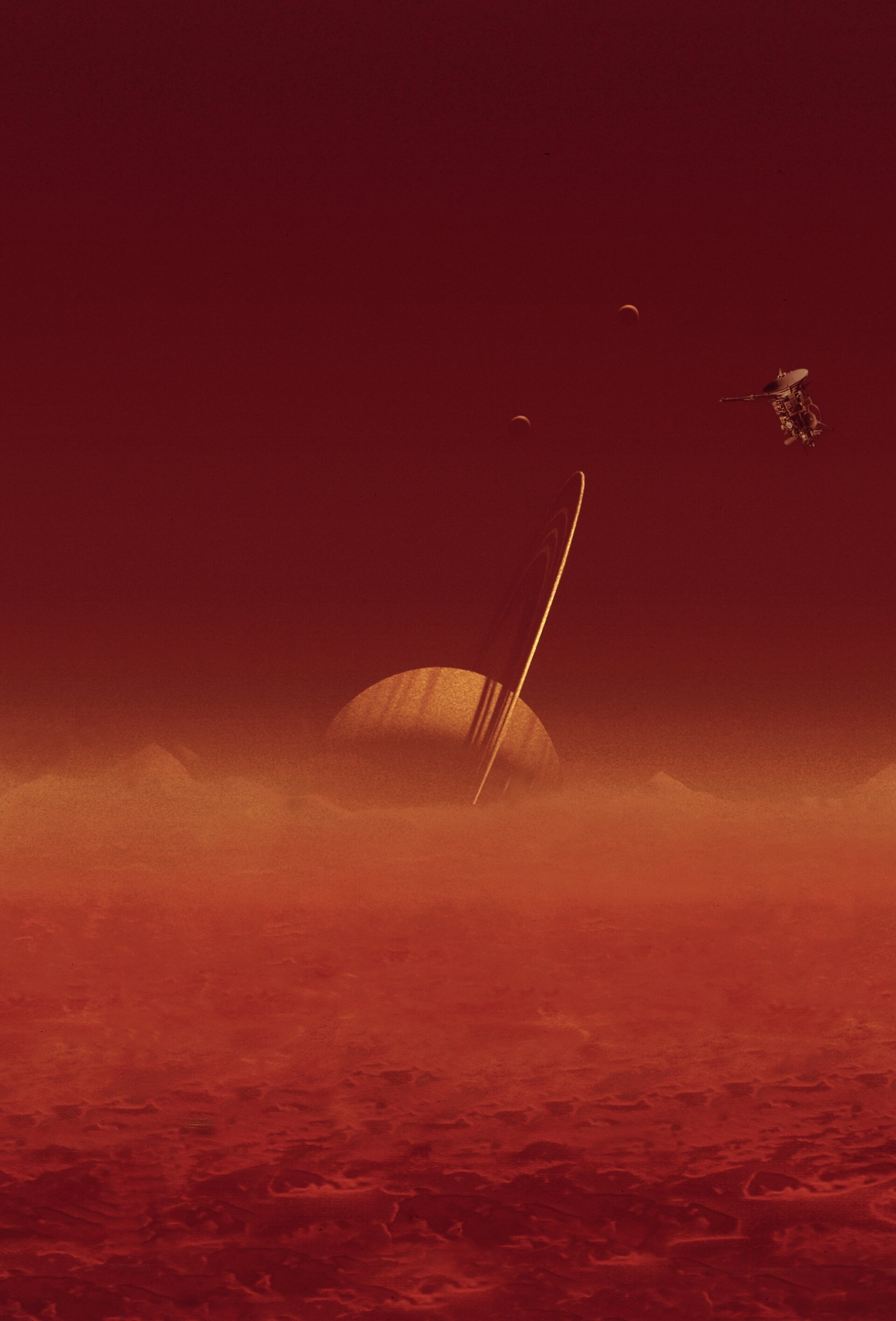 Saturn, as seen from Titan, with Cassini just visible