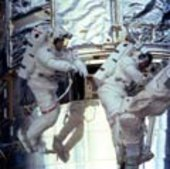 Astronauts Foale and Nicollier work on Hubble