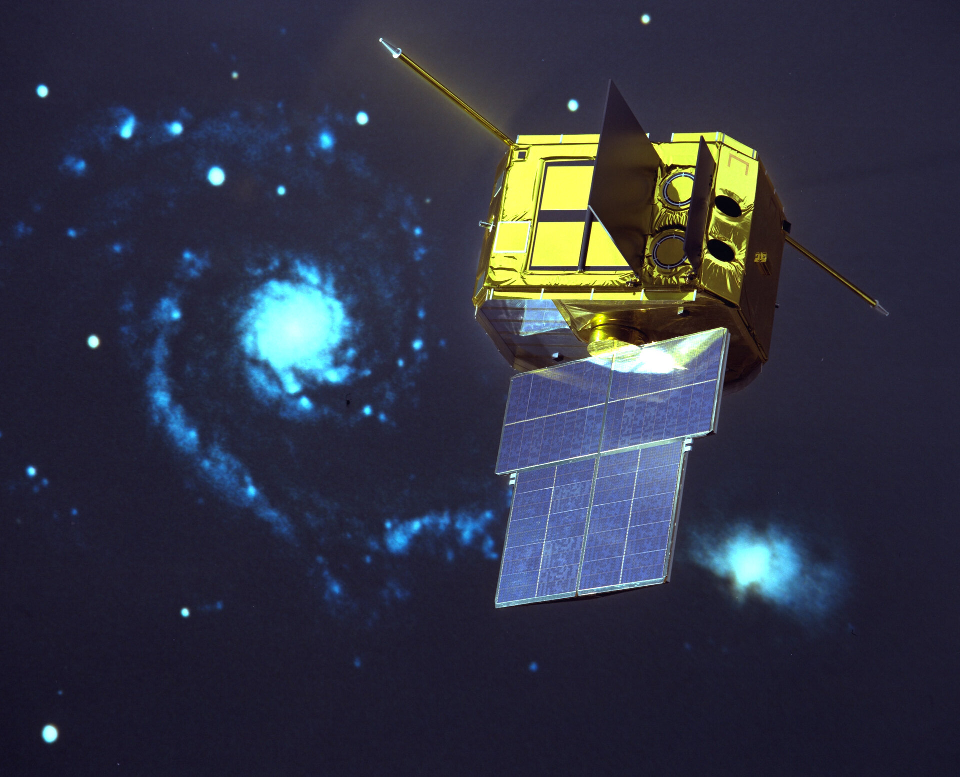 Model of ESA's Exosat X-ray satellite with the Whirlpool Galaxy as a backdrop