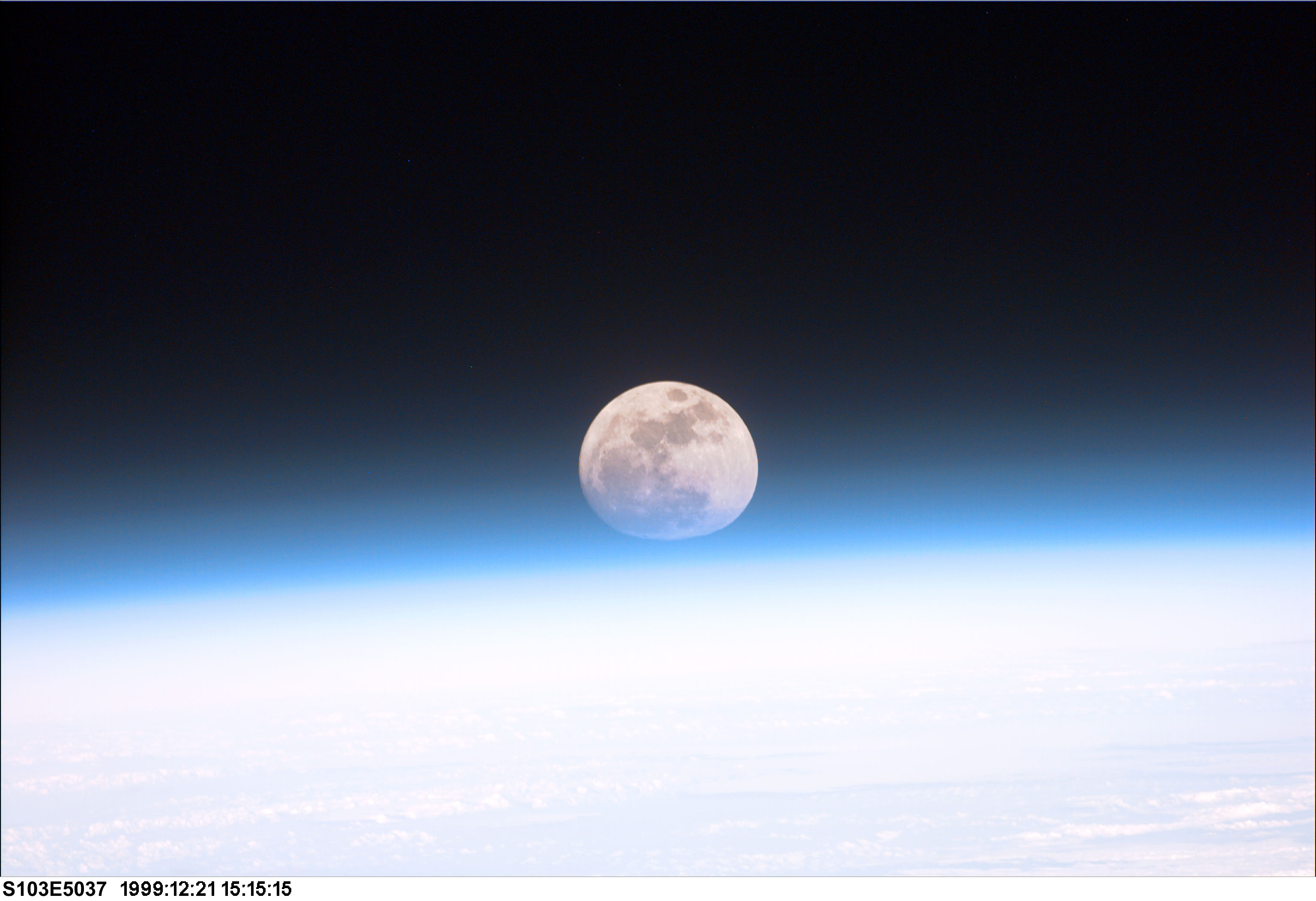 space in images 2003 05 space shuttle discovery sees earth s moon