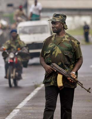 A government soldier on patrol in Monrovia, Liberia