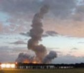 A trail of smoke marks the path of the Space Shuttle Colombia