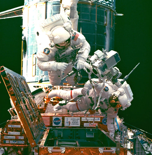 An EVA during STS-82, a servicing mission for the Hubble Space Telescope (HST)