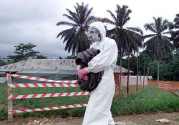 Health workers wear protection against the highly infectious Ebola virus