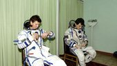 Padalka and Duque are donning their Sokol pressure suits