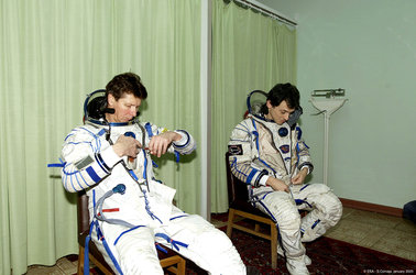 Gennady Padalka and Pedro Duque are donning their Sokol pressure suits - Star City