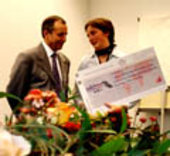 Michel Tognini presents Regina Egelhofer with her award