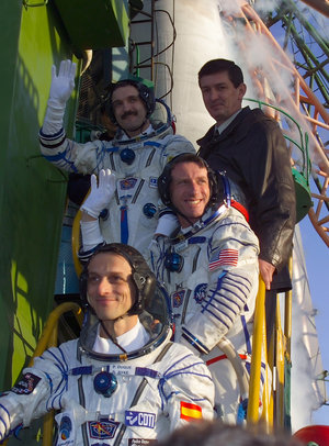 The crew of the Cervantes Mission climbs the stairs to the Soyuz TMA-3