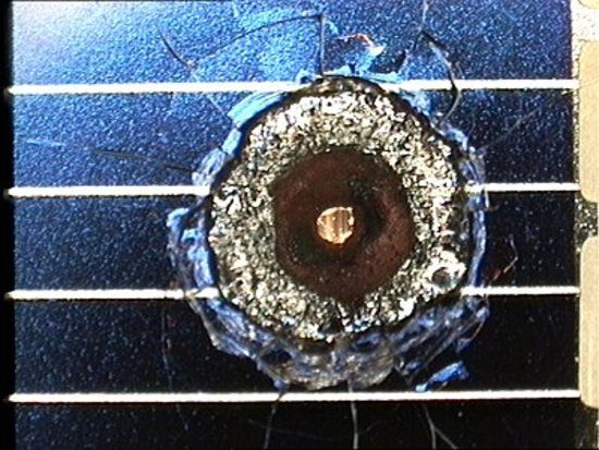 Impact crater (size 4 mm) on solar cell retrieved from space