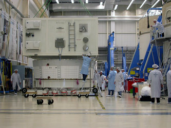 The Jules Verne Equipped Avionics Bay flight hardware is removed from its container box after arrival from Toulouse