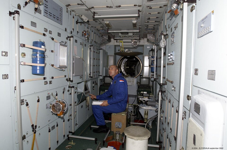 André Kuipers trains inside a full-sized ISS model