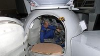 Entering Soyuz simulator
